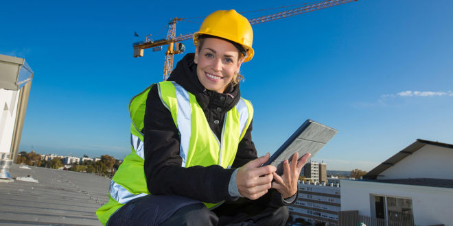 Female worker on rooftop.